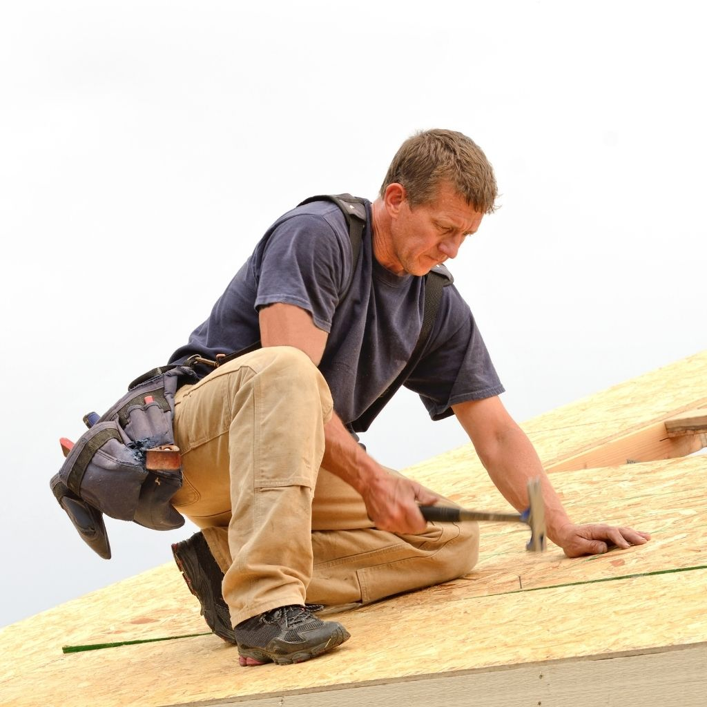 man installing a new roof